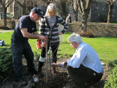 David Purkiss, Lynda Brown and Richard Paget plant an apple tree in Priory Gardens