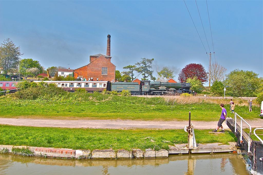 A steam train runs past Crofton Beam Engines