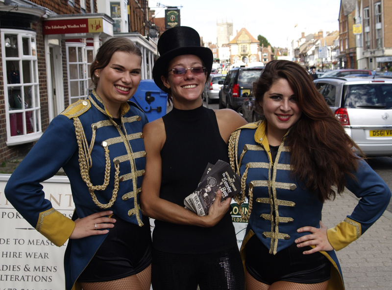 Ella, Ceri and Hannah from Gifford's Circus urge the crowds to roll up, roll up!