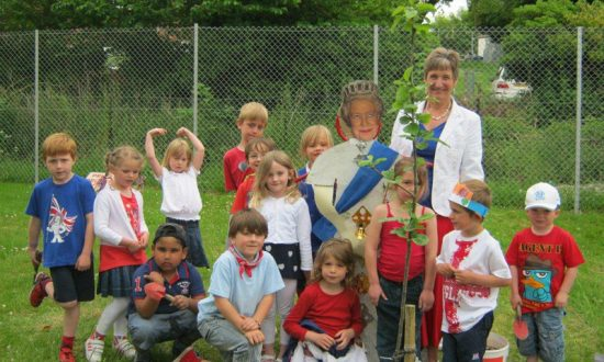 Children from St Mary's Infants celebrating the Queen's Diamond Jubilee by planting an apple tree as part of the Community Orchard project