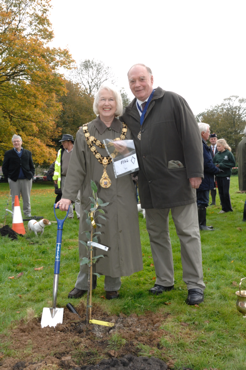 Mayor and Cllr Nick Foog standing beside the Burn's Seedling she planted to mark her mayoral year
