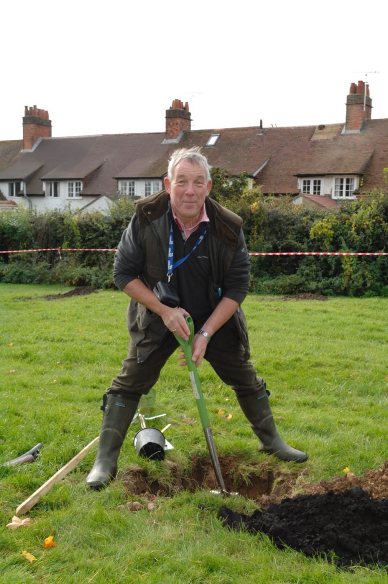 Nigel Kerton gets down to planting a tree for the Marlborough Gardening Association