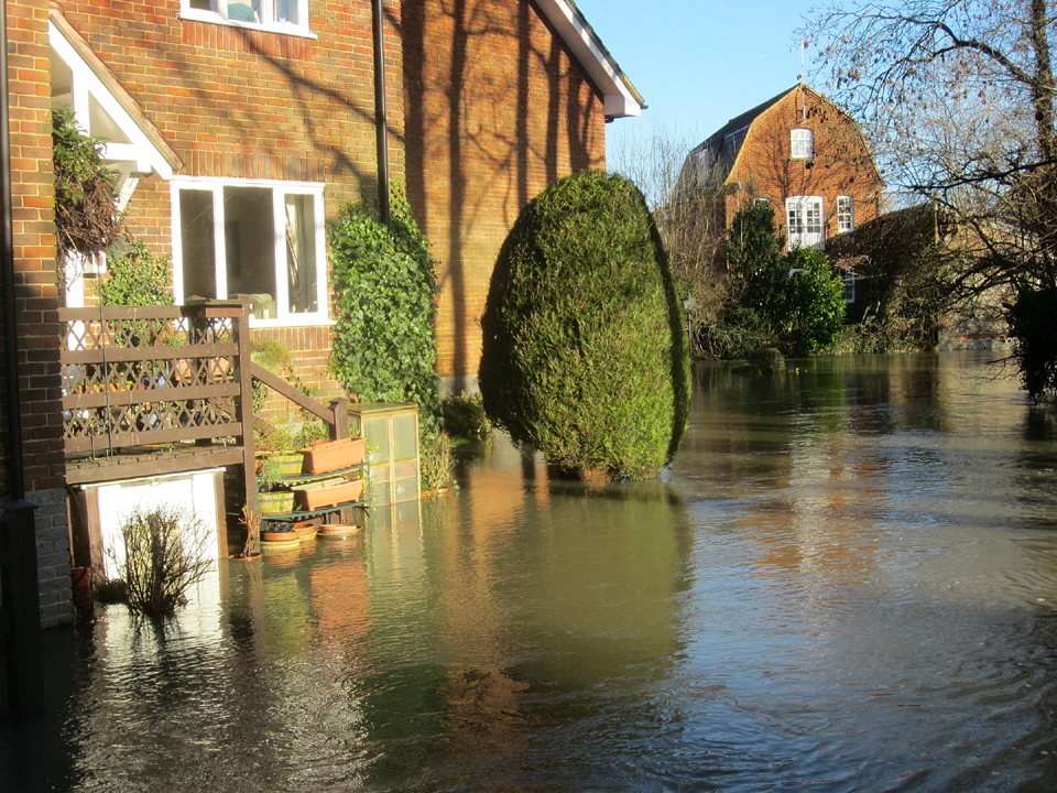 Flooding lapping the edges of Town Mill