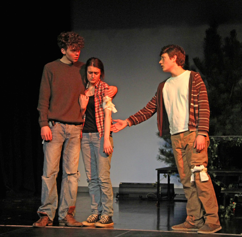 L to R: Tristan (Christopher Baker), his wounded sister Cora (Alex Watts) & Joshua (Henry Leigh)