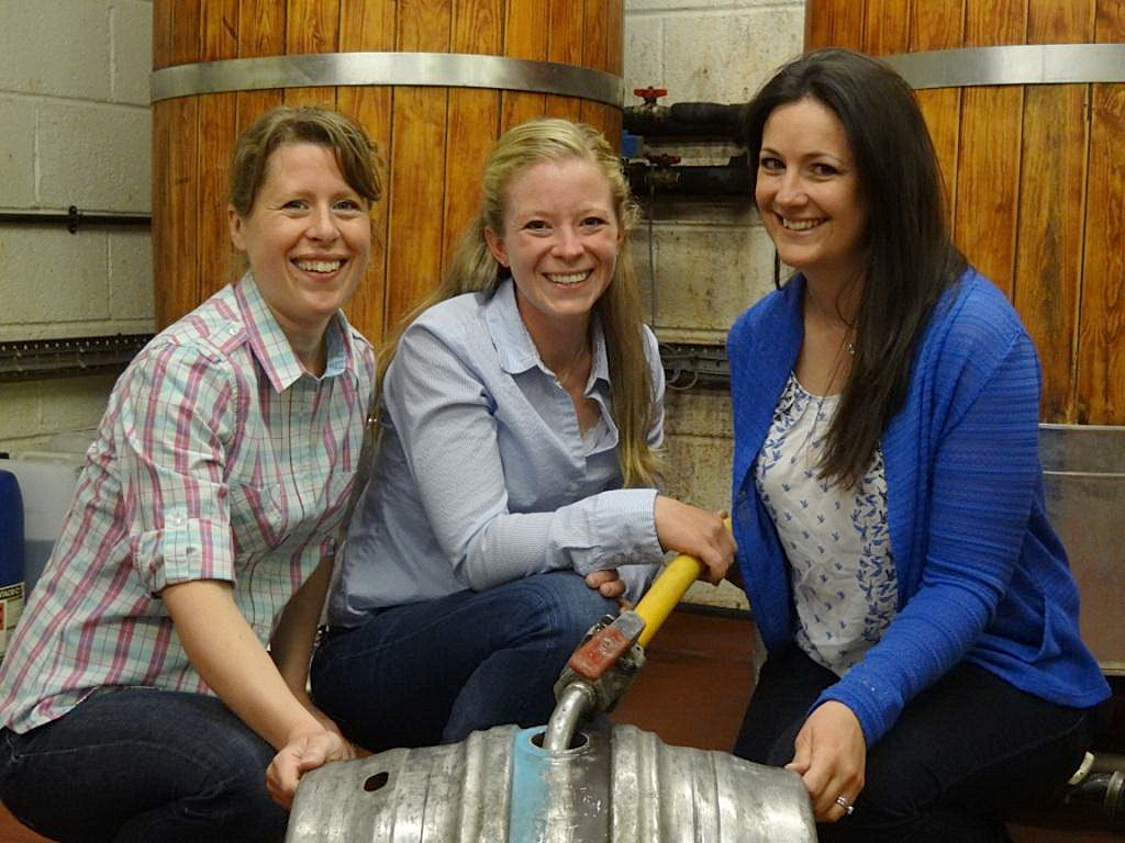 Left to right: Farmers Laura Cooper, Suzie Swanton and Katie Guest help to fill a barrel with their Farmer's Friend ale at Wadworth Brewery in Devizes last week