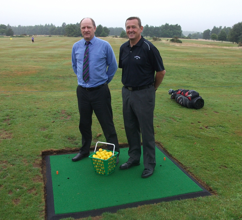Les Trute and Simon Amor on one of the practice tee mats