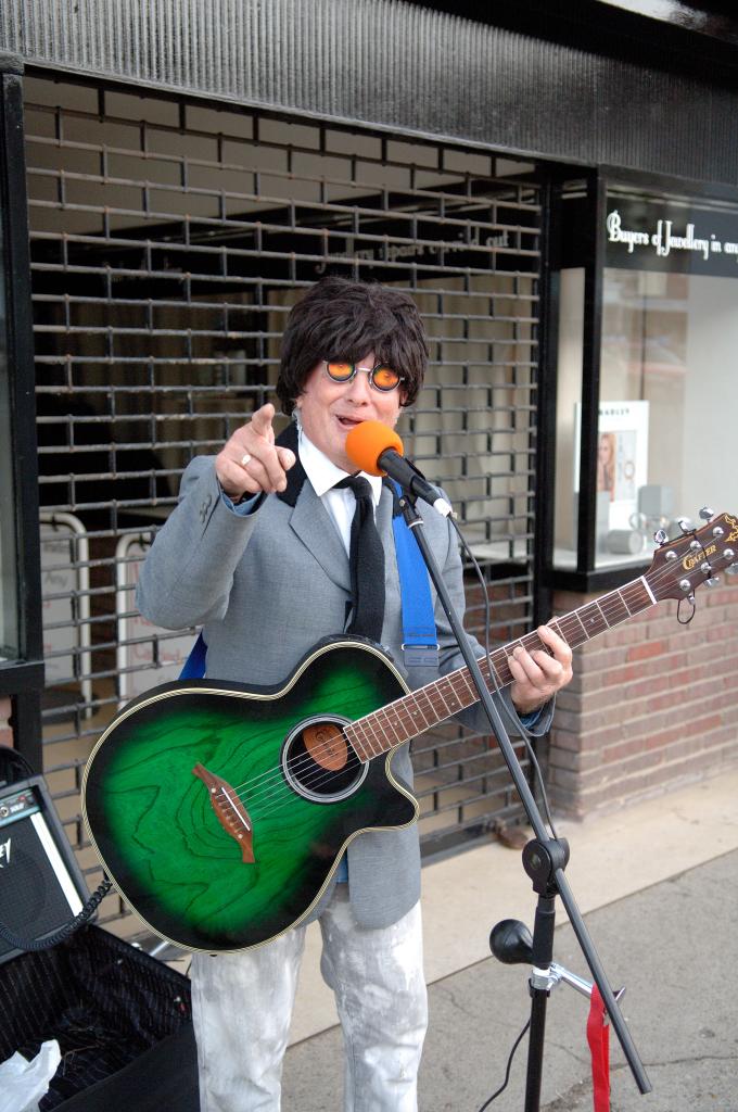 Micky Marlborough busking on the High Street