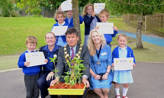 Sarah Hart, community Champion at Tesco, mayor Guy Loosmore and mayoress Fiona Lawson present certificates to St Mary's School pupils Callum, Madison, Lucy, Ava, Dylan and Daisy – growers of the award-winning sunflowers