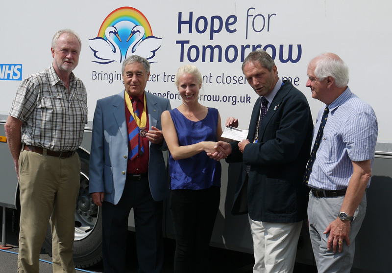 Rotary President Paul Cowan presents Hope for Tomorrow's Rosa Woodley with the cheque