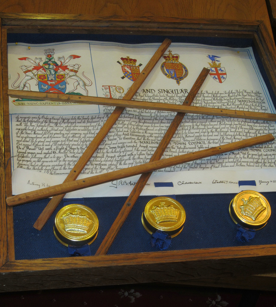 The smashed glass case holding Marlboroughs Grant of Arms certificate with below it three seals which the thieves thought we made of gold.  They are in fact made of gold-painted tin