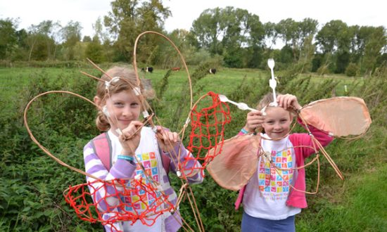 Rosie and Lucy with their Stonebridge bugs