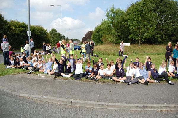 Children prepare to welcome the peloton to Burbage