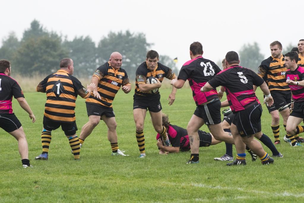 Rhys Butler breaks through a tackle