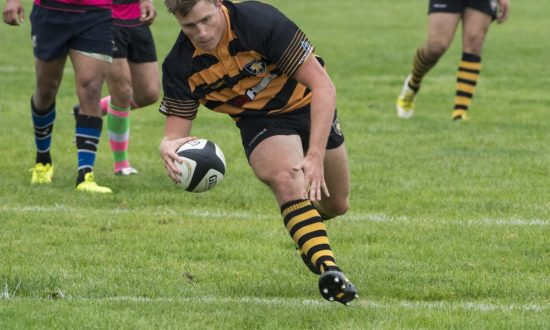 Russ Westcott touches down underneath the posts