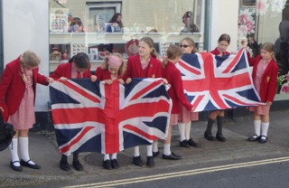 Children from St Francis School try to ensure their Union Flag is the right way up