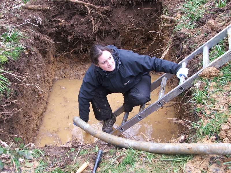 Archaeologist Jo Ramsay clearing water from the excavations