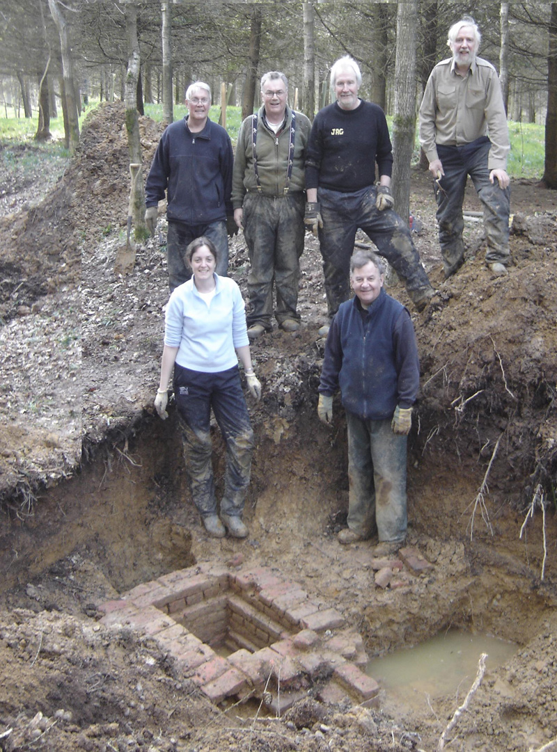 Members of the Wiltshire Archaeology Field Group at the head of the conduit - with water still flowing through it