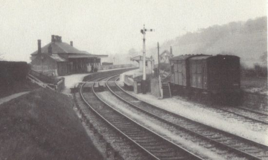 This is a view of Marlborough (Low Level) station looking towards Swindon. The line was single track except when it went through stations. Behind the wagons is site of the Tesco store and just past the signal is the bridge over the Salisbury Road. The buttresses of this bridge are still visible on the Salisbury Road. The new care home and assisted living units are now being built on this site. Photo reproduced by kind permission of Michael Gray