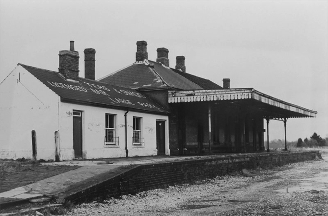 """The building on the left is the """"Fresher"""", which was the old refreshment room at the station. It stayed open long after the railway line closed and was a popular watering hole and pub for that part of town in the late 1960's. Harold Trotman was the landlord."""