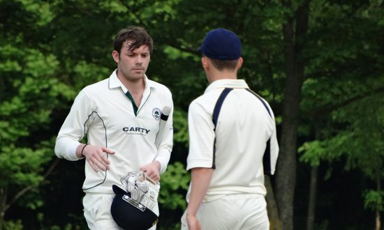 Penners (Penfold) being congratulated on his century