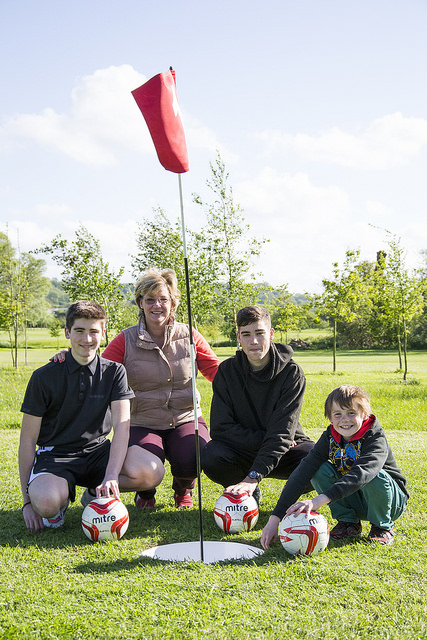 Playing Football Golf  Will and Alex Baker and Milo Davison with Juliette Nutland of Basset Down Golf Course