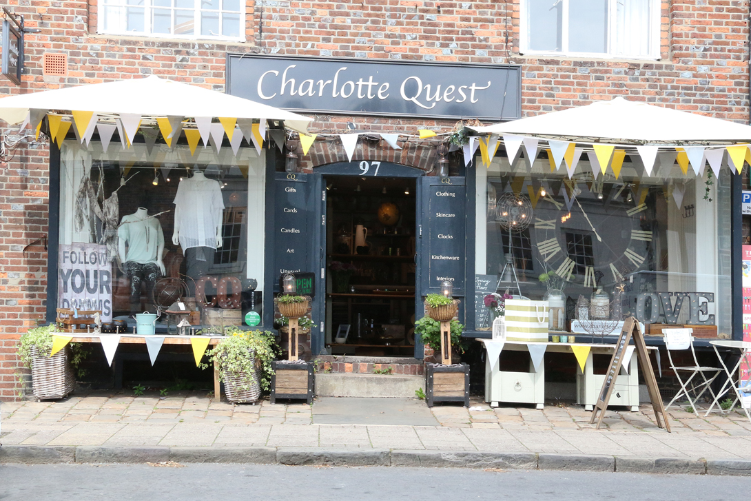 Charlotte Quest shop top side of High Street with 'citrus' bunting