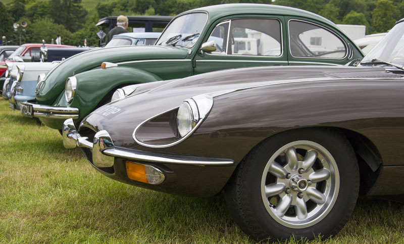A 1969 E-Type Jaguar, 1972 VW Beetle 1302S, and a Triumph Herald  from 1960