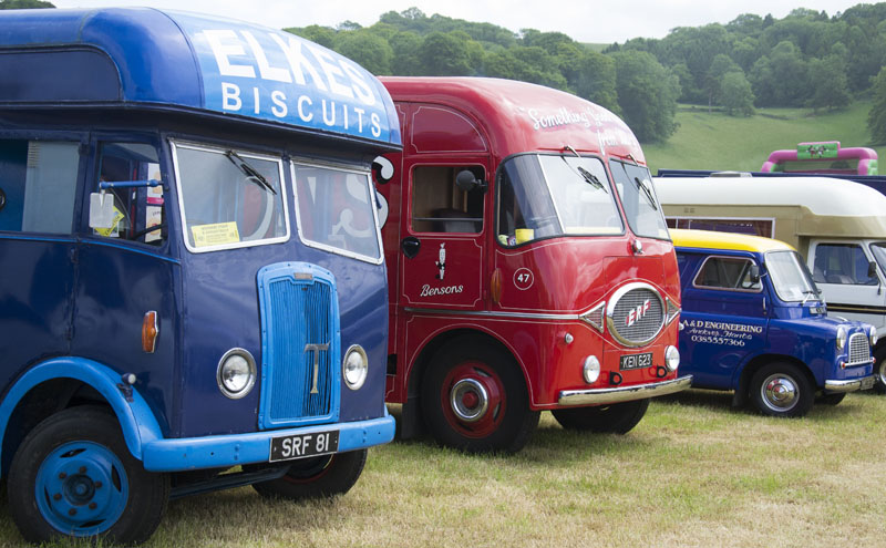 A 1949 Thornycroft delivery van in Elkes Biscuits livery, a 1959 Bensons Sweets delivery van, and a Bedford Morris van