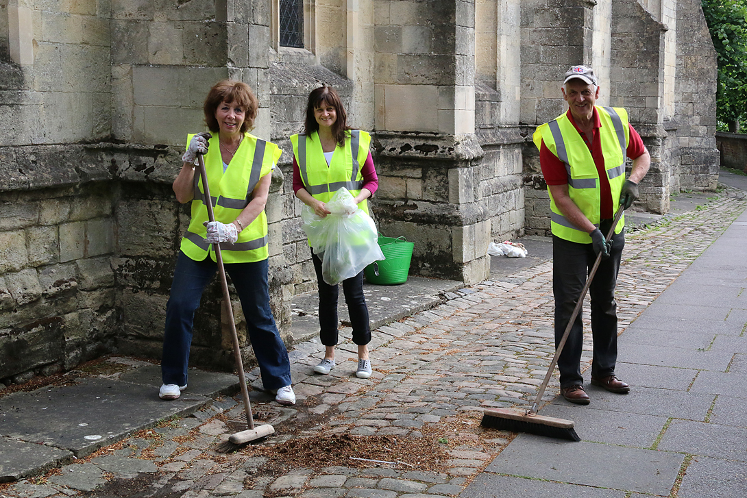 Councillors Stewart Dobson and Marian Hannaford-Dobson with Town Clerk Shelley Parker working hard at clearing up St Marys Church