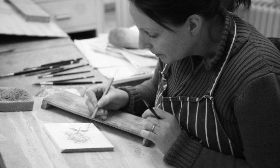 Artist Kirsty Robinson at work at Marlborough Tiles