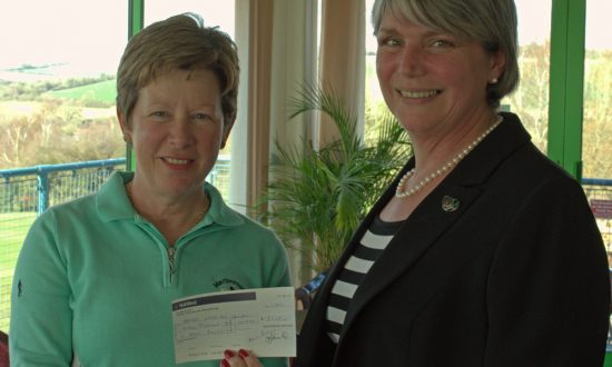 Ruth Hodgson (left) hands the cheque to Anne Ainsworth of Target Ovarian Cancer