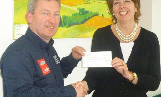 Jon Horsley presents a cheque to Nicky Edmondson