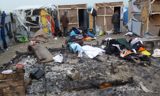 "Nick Maurice adds: ""These are three of the estimated 50 homes belonging to Sudanese migrants that were burnt out. Now replaced with donated tents from Care4Calais. Fortunately our caravans are intact and our 'surgeries' continue."""