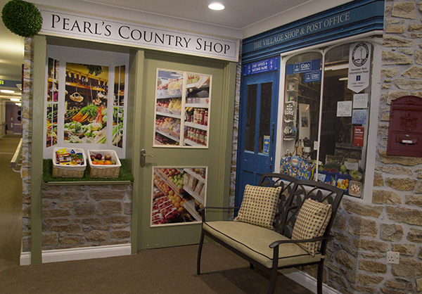 One corner of the home has been transformed into a village shop to promote reminiscence