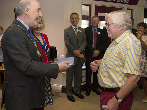 Resident Tim presents the mayor with a book about the history of the Order of St John