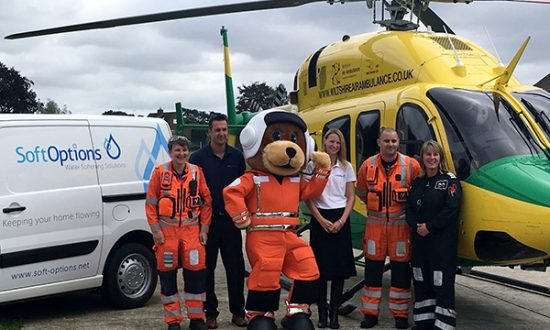 Simon Neate and Alison Cook from Soft Options Water Softeners Ltd with paramedics Louise Cox and Matt Baskerville, pilot Nicky Smith, and the as yet un-named mascot