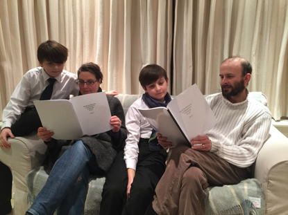 The Piercy Family (Claudia, Nic, Noah and Timon) studying the script for the Marlborough Community Passion Play
