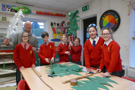 Members of St Francis's School art club with Vincent Stokes make palm leaves for the Marlborough Community Passion Play