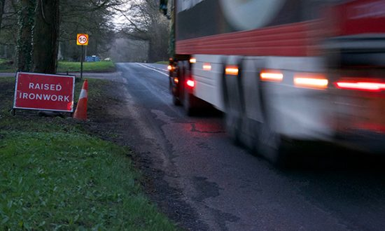 A lorry passes along the A346 at Cadley where the road surface is badly worn