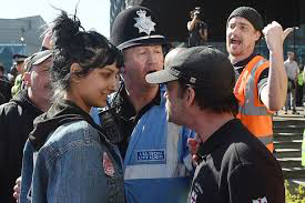 Saffiyah Khan smiles at the EDL leader