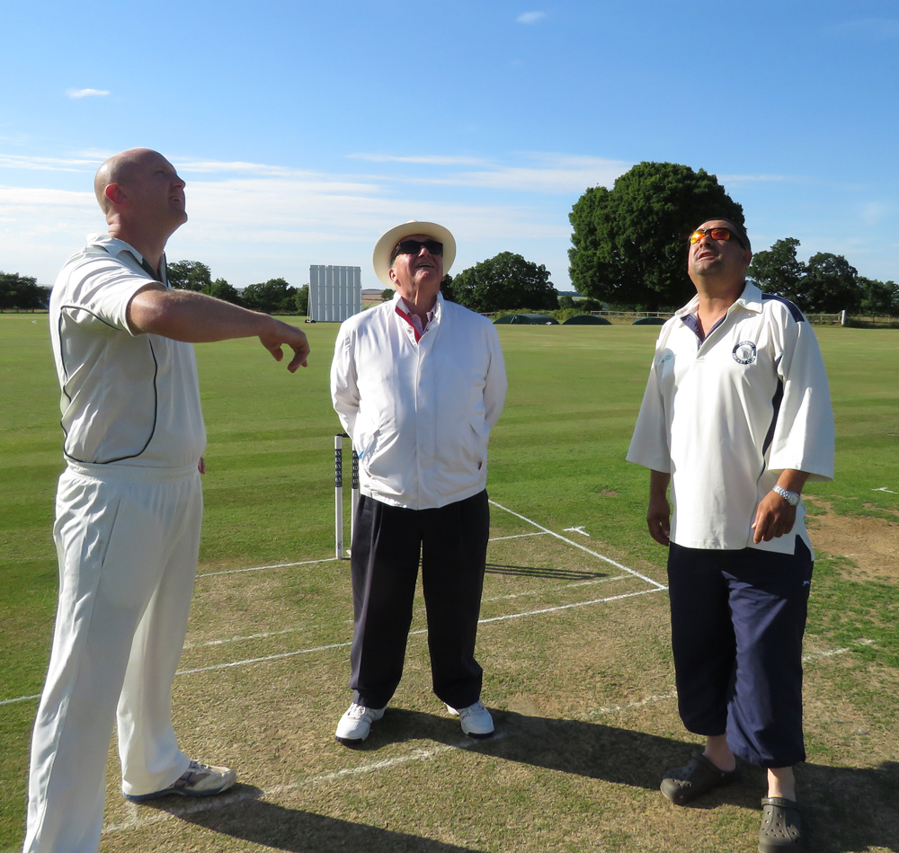 Into orbit? Marlborough Captain George Fox tosses the coin watched by umpire Derek Fuller-Webster and Mayor's XX captain Greg Dix