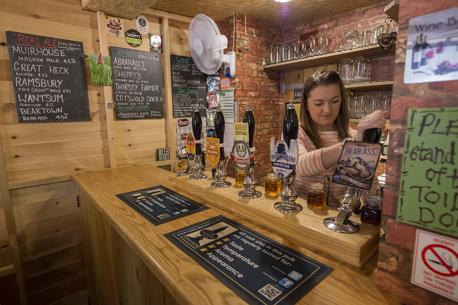 The 'sharp end' of The Shed - Alice pulling pints of well-crafted ale