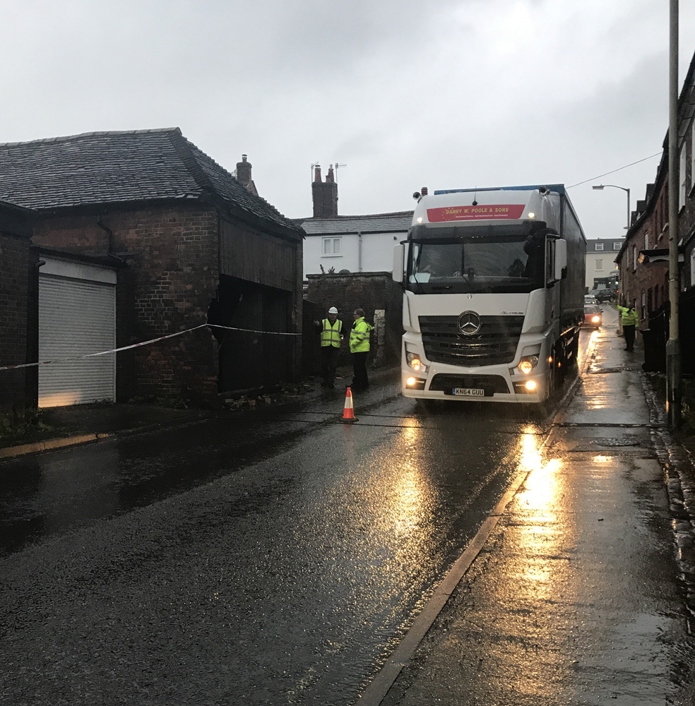 Another HGV passes the damaged garage in Barn Street