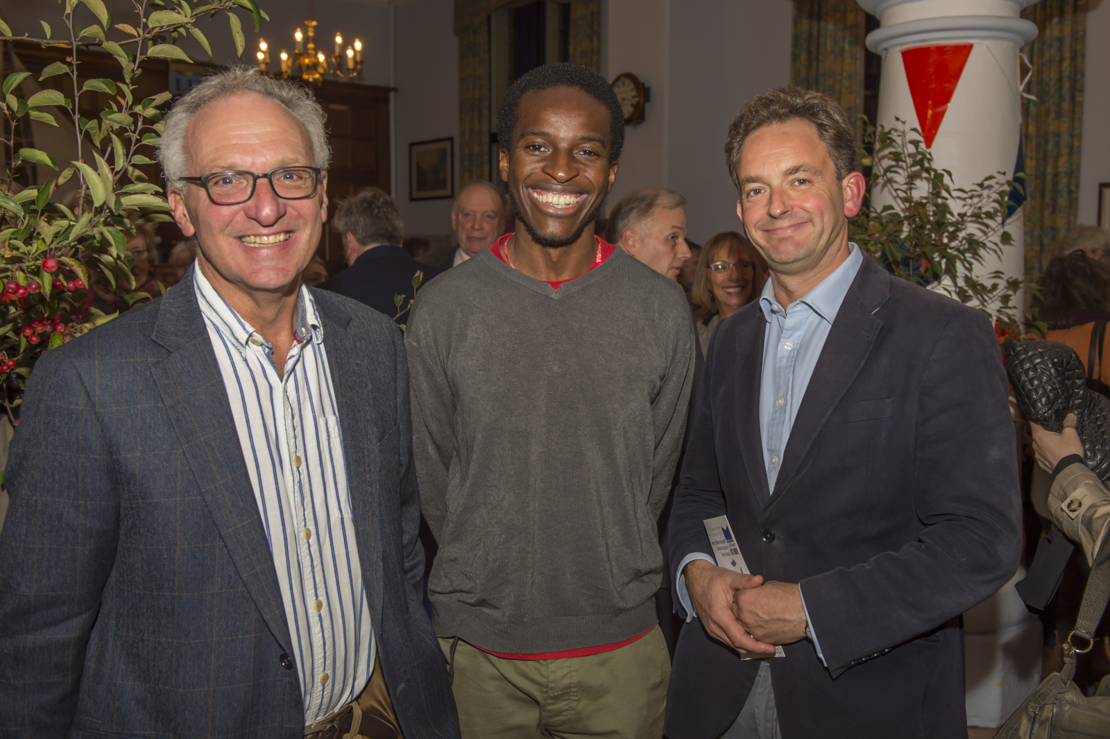 Poet Kayo Chingonyi flanked by Mike Ponsford (left) & Nick Gordon from Marlborough College