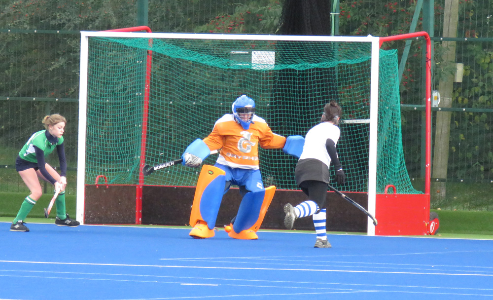 MHC Ladies Thirds:  waiting in vain - the Devizes keeper stops a good cross
