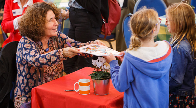 Francesca Simon signs books for her readers (Photo copyright Ben Phillips)