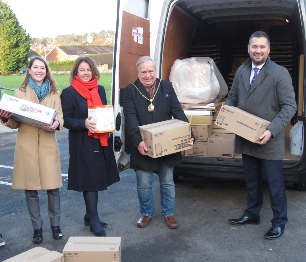Let the unloading begin - l to r Nicki Beswarick, Liz Griffin, the Town Mayor and Shane Paull
