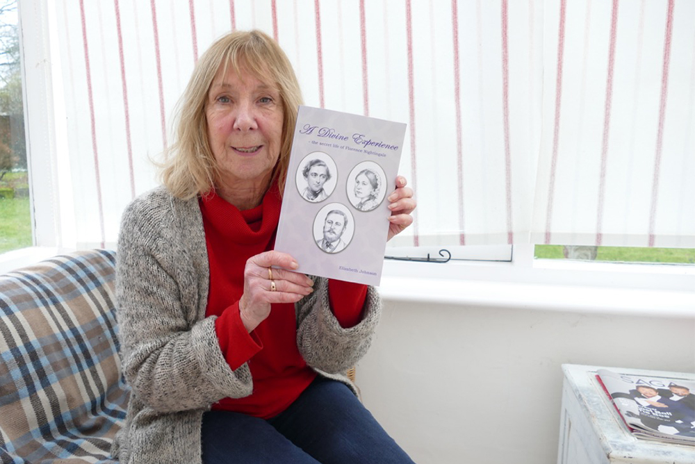 Elizabeth Johnson with her book 'A Divine Experience'