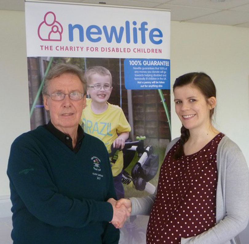 Patrick Shaw hands Meredith Lambert a £1,600 cheque for Newlife
