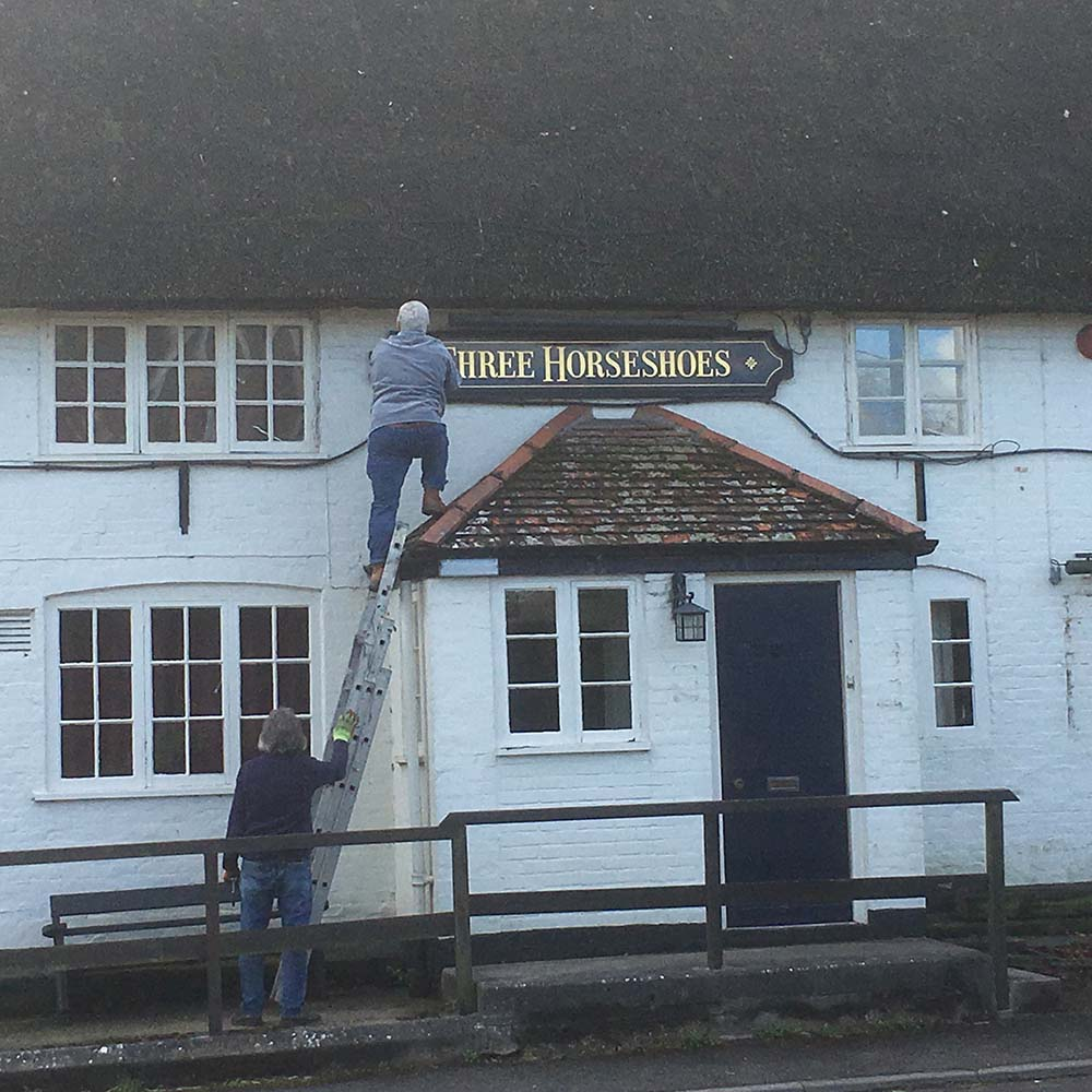Three Horsehoes sign being removed - death of a once-popular pub?
